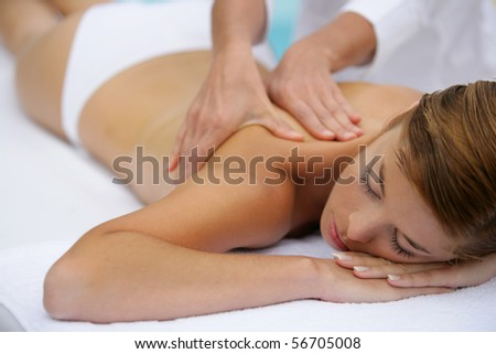 Young woman being massaged - stock photo