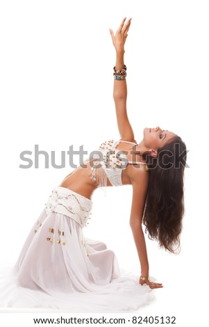 young woman belly dancer in white costume isolated on white background - stock photo