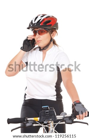 Young woman biker with her bike isolated over white background talking on the phone - stock photo