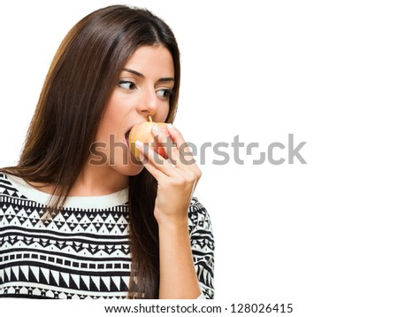 Young Woman Bitting an Apple against a white background - stock photo