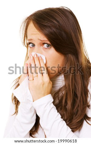 young woman blow one's nose. isolated on white