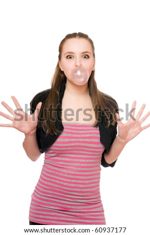 Young woman blowing a bubble from chewing gum - stock photo