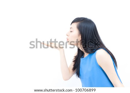 young woman blowing a kiss, isolated on white background
