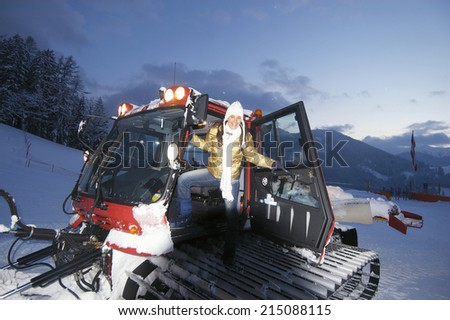 Young woman boarding sno-cat - stock photo