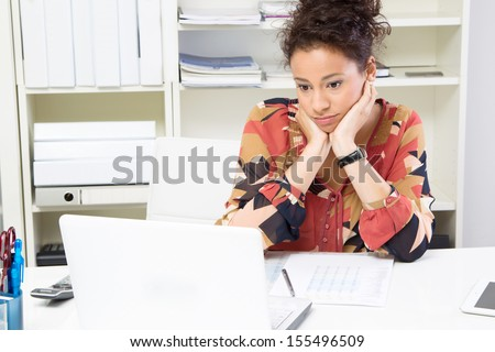 Young woman bored while working in office - stock photo