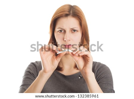 young woman breaking a cigarette in disgust on a white background isolated