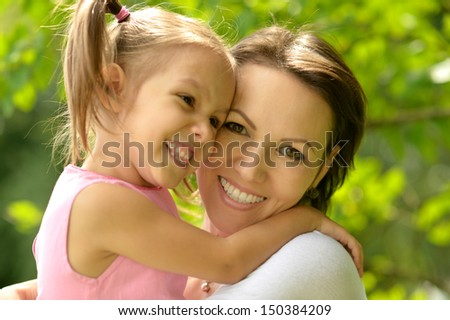 young woman brought to walk her little daughter - stock photo