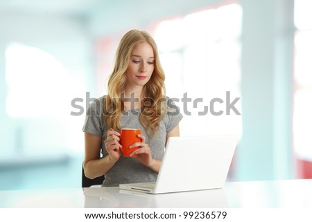 Young woman browsing on computer in the office