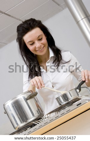 young woman brunette caucasian cooking in her kitchen