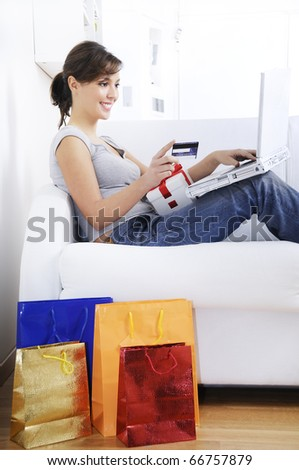 young woman buying with credit card and laptop on internet, concept of shopping online