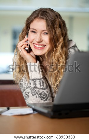 Young woman buys on the web - stock photo