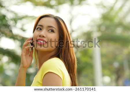 Young woman calling outdoors - stock photo