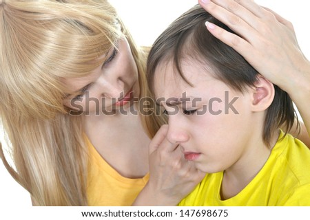young woman calming a sad boy on a white background