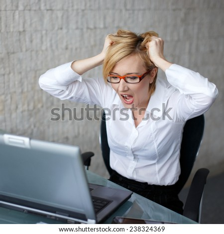 Young woman can't handle that workload anymore, too much - stock photo