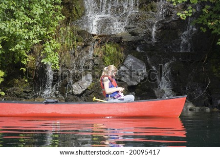 Young woman canoeing, Canada - stock photo