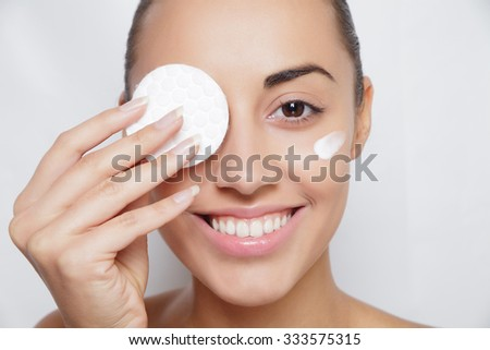 young woman cares for face skin relaxation, leisure, neck, innocence, bright, serene, sexuality, Woman using cotton pad - stock photo