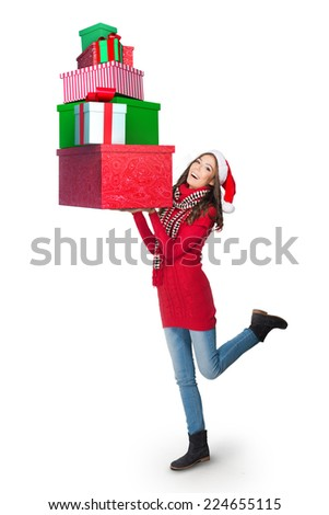 Young woman carrying a pile of presents - stock photo