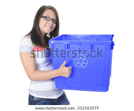 Young woman carrying a plastic container full with empty recyclable household material. Recycling concept - stock photo