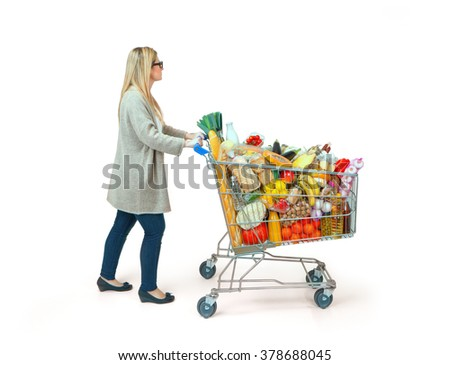 Young woman carrying a shopping cart - stock photo