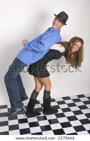 Young woman carrying picking up her boyfriend while playing around - stock photo