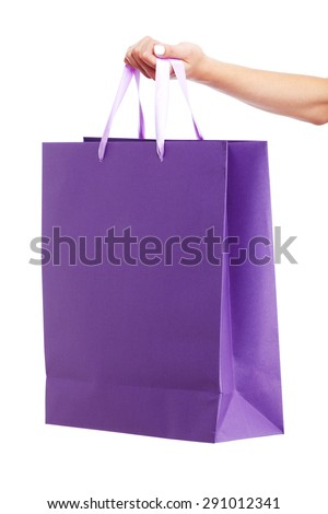 Young woman carrying shopping bag isolated on white background
