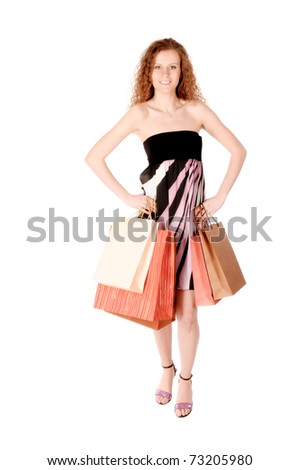 Young woman carrying shopping bags isolated on the white background