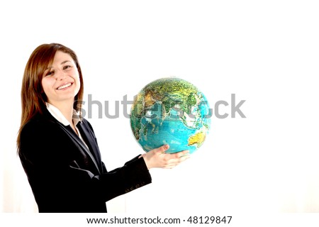 Young woman carrying the world in your hands. She holds a globe and smiling. - stock photo