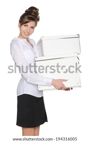 Young woman carrying white boxes isolated on white