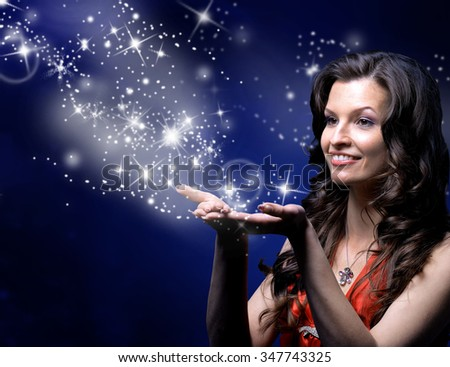 young woman catches Star rain by hands - stock photo