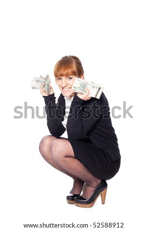 Young woman cath falling money - stock photo
