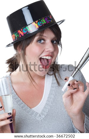 Young woman celebrates New Years; isolated on a white background. - stock photo