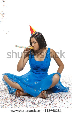 young woman celebrating during carnival party. white background. - stock photo