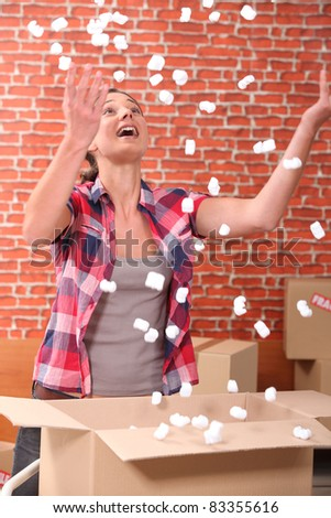 Young woman celebrating removal - stock photo