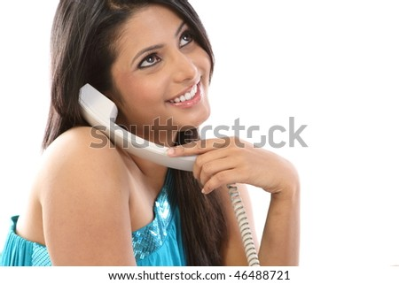 Young woman chatting in the telephone receiver - stock photo