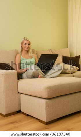 Young woman chatting on a laptop at home