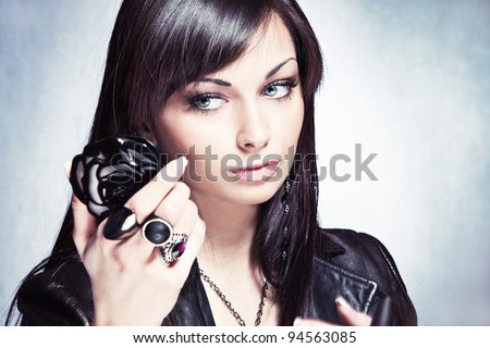 young woman check her look at  hand mirror - stock photo