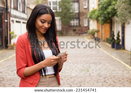 young woman checking her messages - stock photo