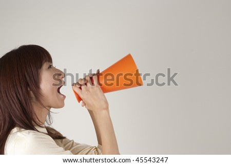 Young woman cheering with megaphone