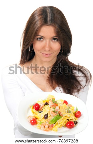 Young woman chef holding the plate with italian lemon pappardelle, tagliatelle, macaroni, spaghetti pasta with tomato, shrimps and olives on it in hand on a white background. Focus on Pasta plate - stock photo