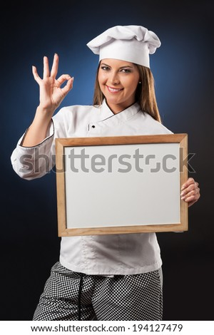 Young woman chef holding white banner