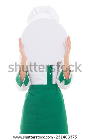 young woman chef in uniform holding big tray behind her face isolated on white background - stock photo