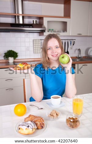 Young woman chooses healthy diet