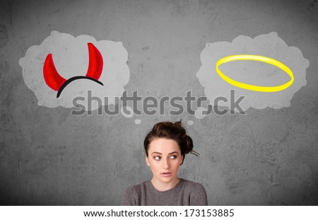 Young woman choosing between the good and the bad - stock photo