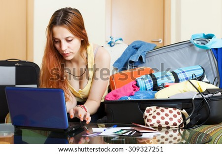 Young woman  choosing hotel online in the internet using laptop  at home