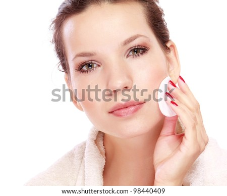 Young woman cleaning face - stock photo