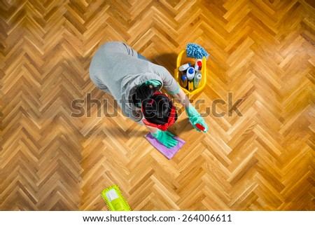 Young woman cleaning  floor at home. View from above. Selective focus - stock photo