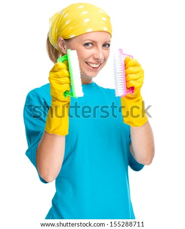 Young woman - cleaning maid with two brushes, isolated over white - stock photo