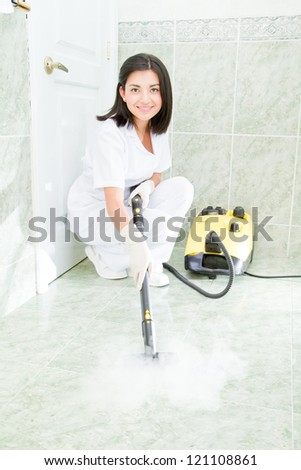 Young woman cleaning the bathroom - stock photo
