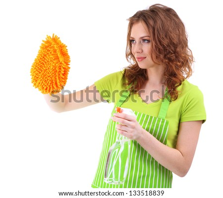 Young woman cleaning windows with sprayer and sponge, isolated on white - stock photo