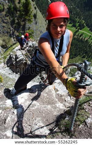 Young woman climbing in the nature, outdoor pursuit. - stock photo